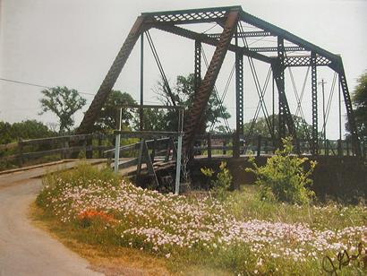 A photo of the bridge before it was moved. Photographer is Jeanie Gold of Dime Box. Photo courtesy Allan Moses.